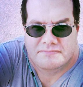 "<img src=""Chad-Nelson.jpg"" alt=""author of the book the black water phenomenon wearing sunglasses looking thoughtful and serious"">"