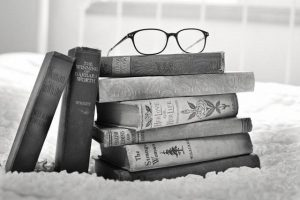 """<img src=""""expand-your-reading-list.jpg"""" alt=""""Bookrack laying on floor with glasses on top"""">"""